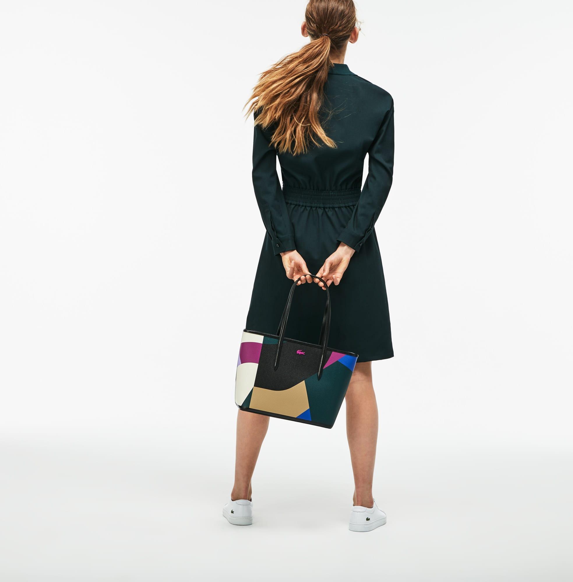 حقيبة صغيرة نسائية من الجلد بألوان متعددة ومزودة بسحّاب