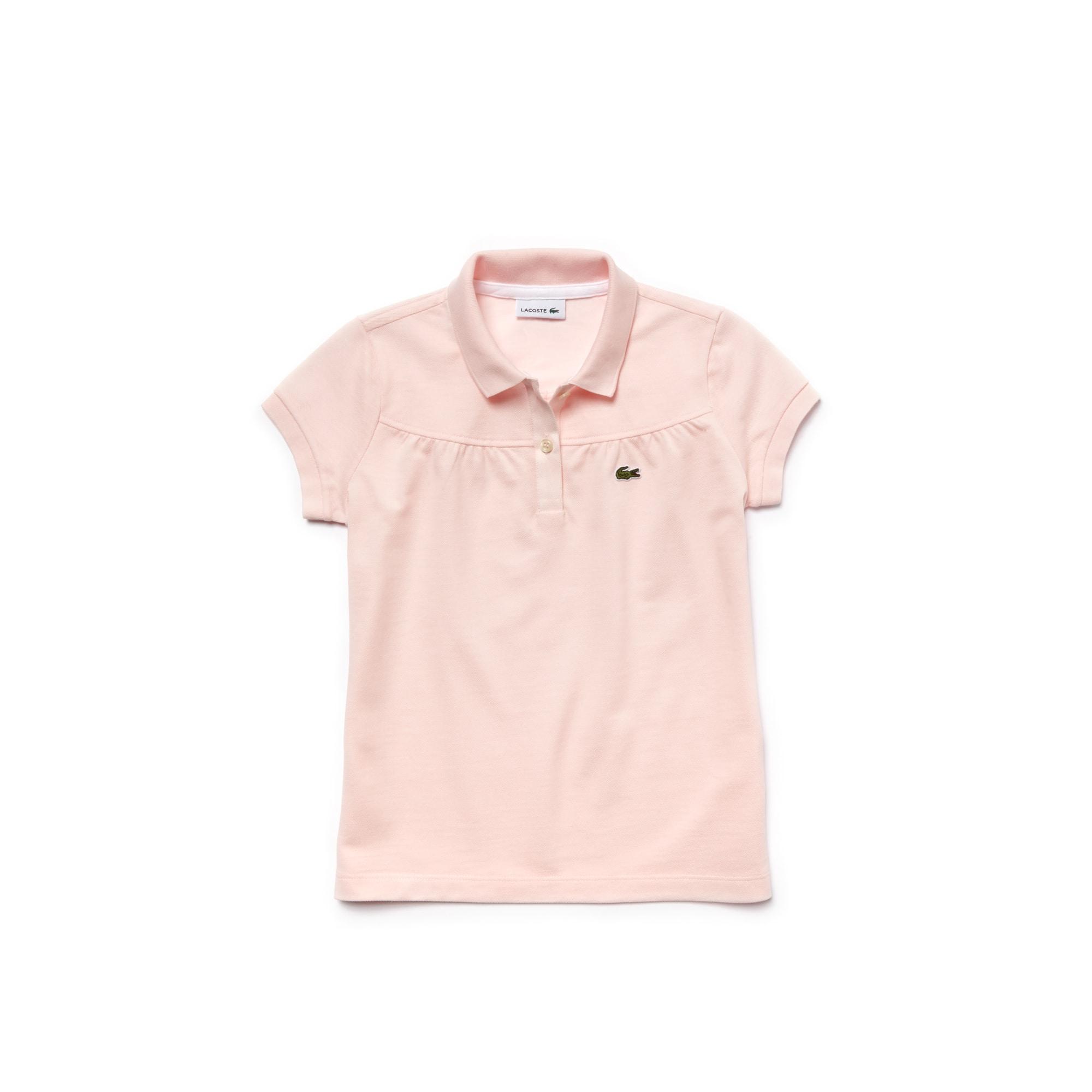 قميص بولو Lacoste مزدان بالطيات ومُحاك بأسلوب ميني بيكيه للأطفال