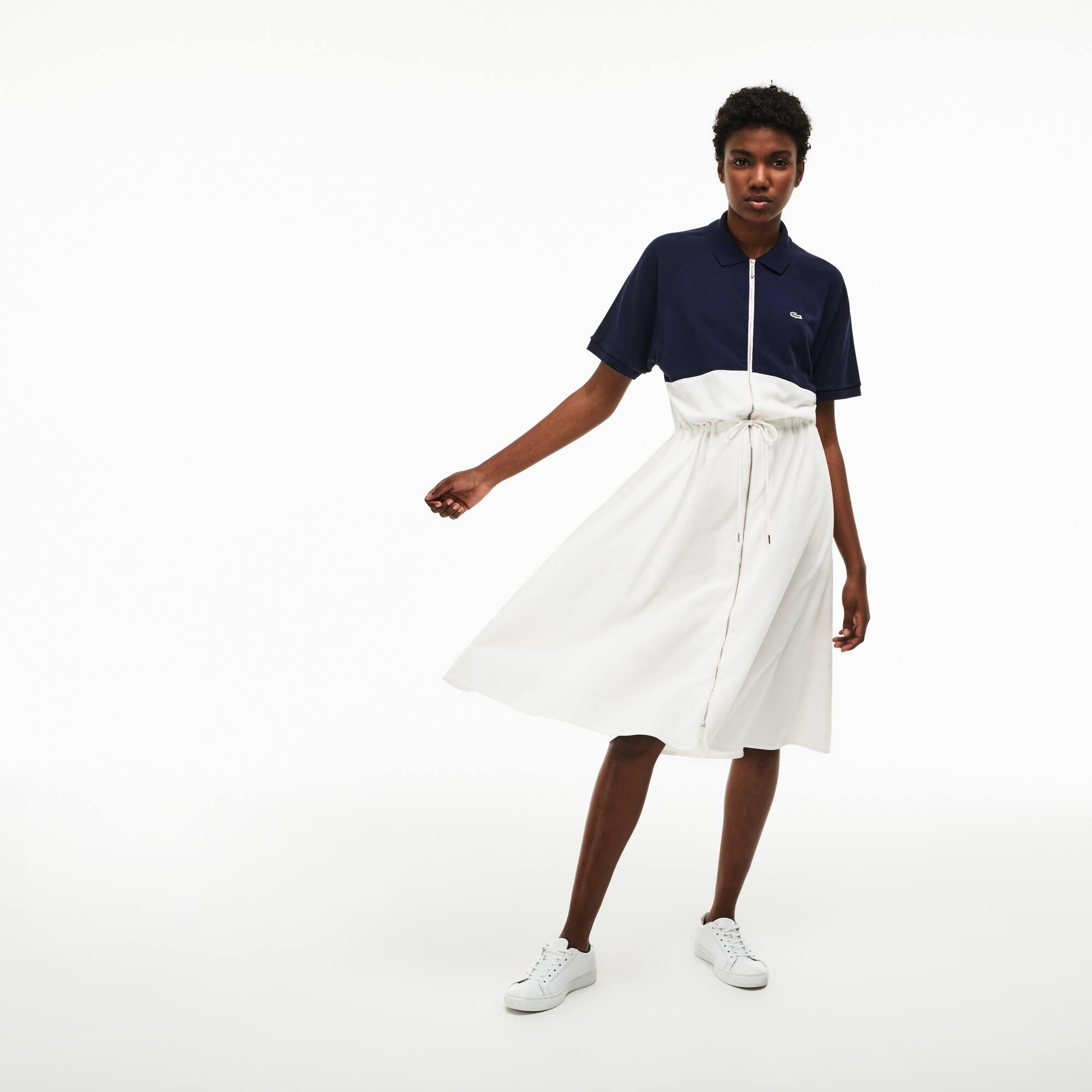 فستان بولو نسائي من لاكوست يتميز بتصميم متصادم الألوان وله سحّاب في خامة بيتي بيكيه القطنية