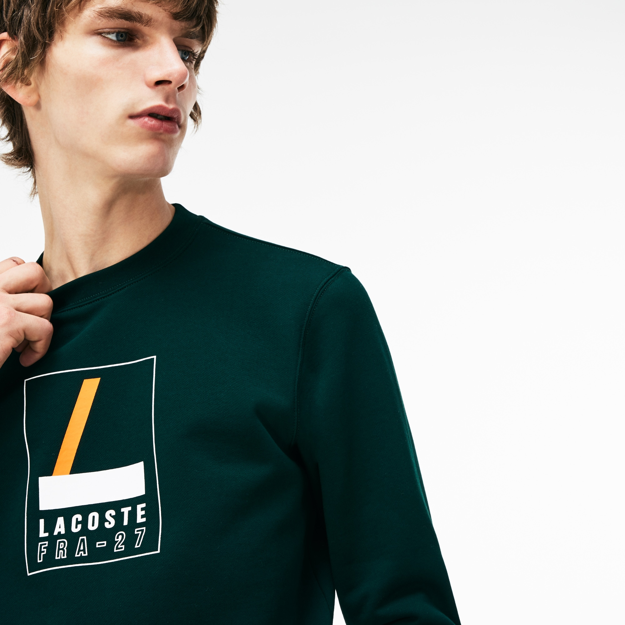 Artikel klicken und genauer betrachten! - Dieses Rundhals-Sweatshirt aus Baumwollfleece steht für urbanes Flair. Grafischer LACOSTE Schriftzug und Rippabschlüsse verleihen diesem Teil Dynamik. | im Online Shop kaufen