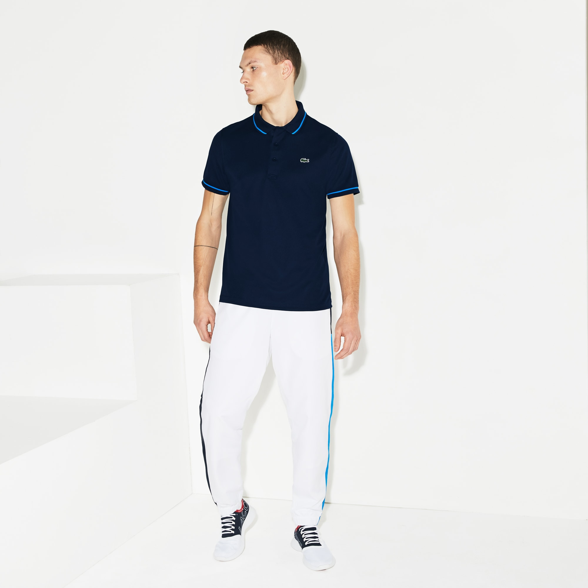 Polo Tennis Lacoste SPORT en piqué technique uni avec piping