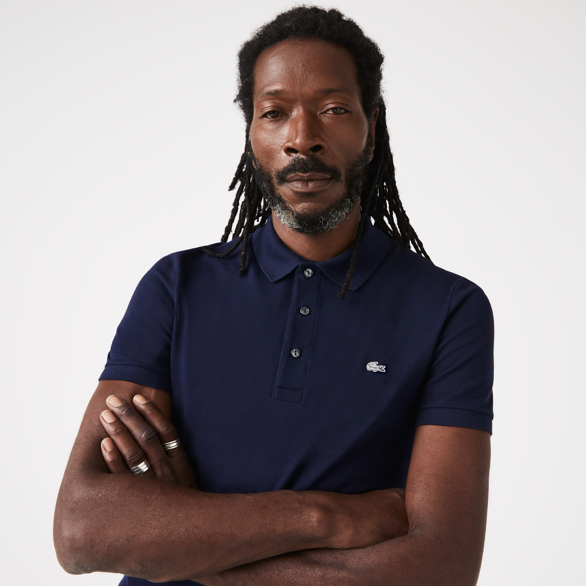 Polo Lacoste slim fit en petit piqué stretch uni