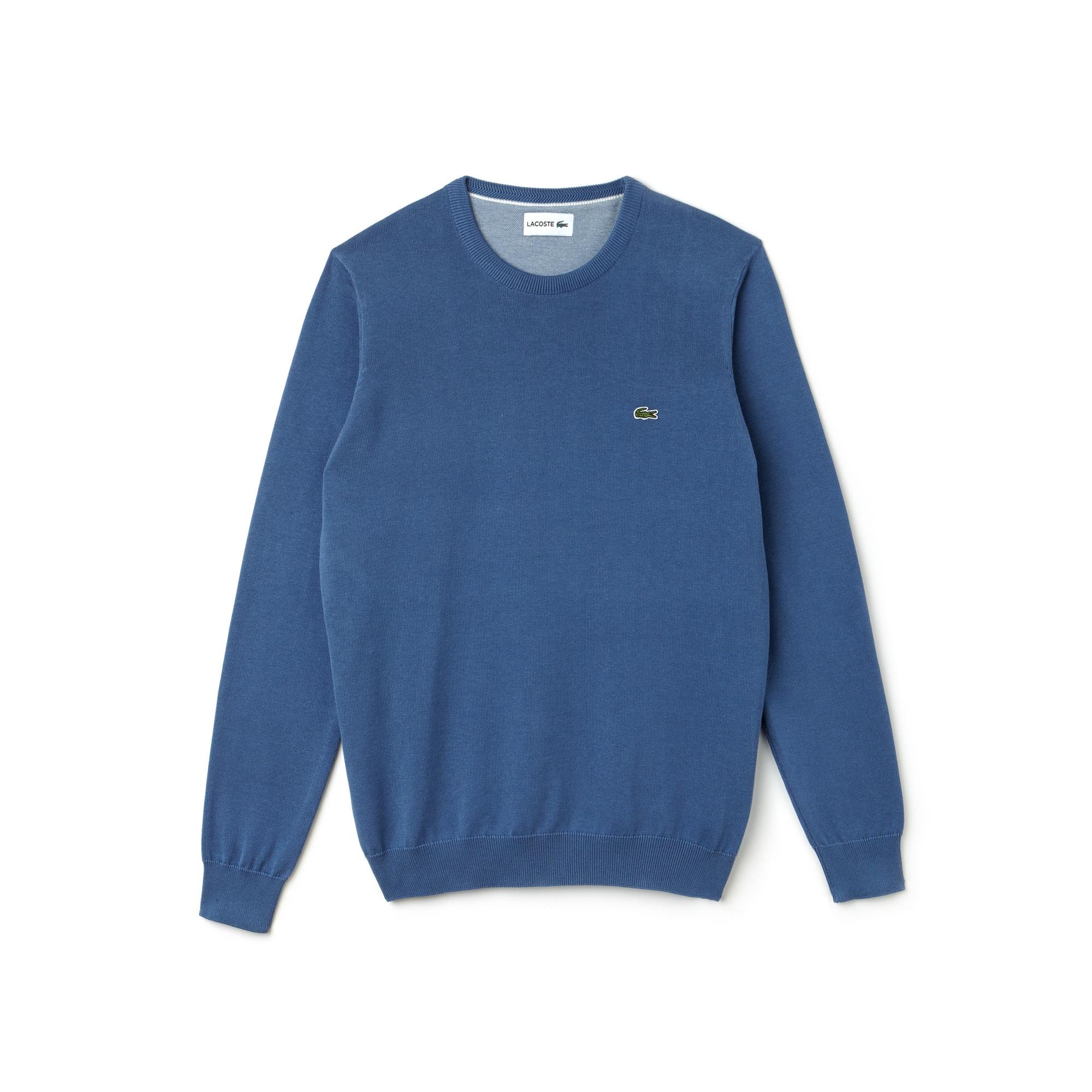 Pull col rond en jersey de coton uni et détail piqué caviar