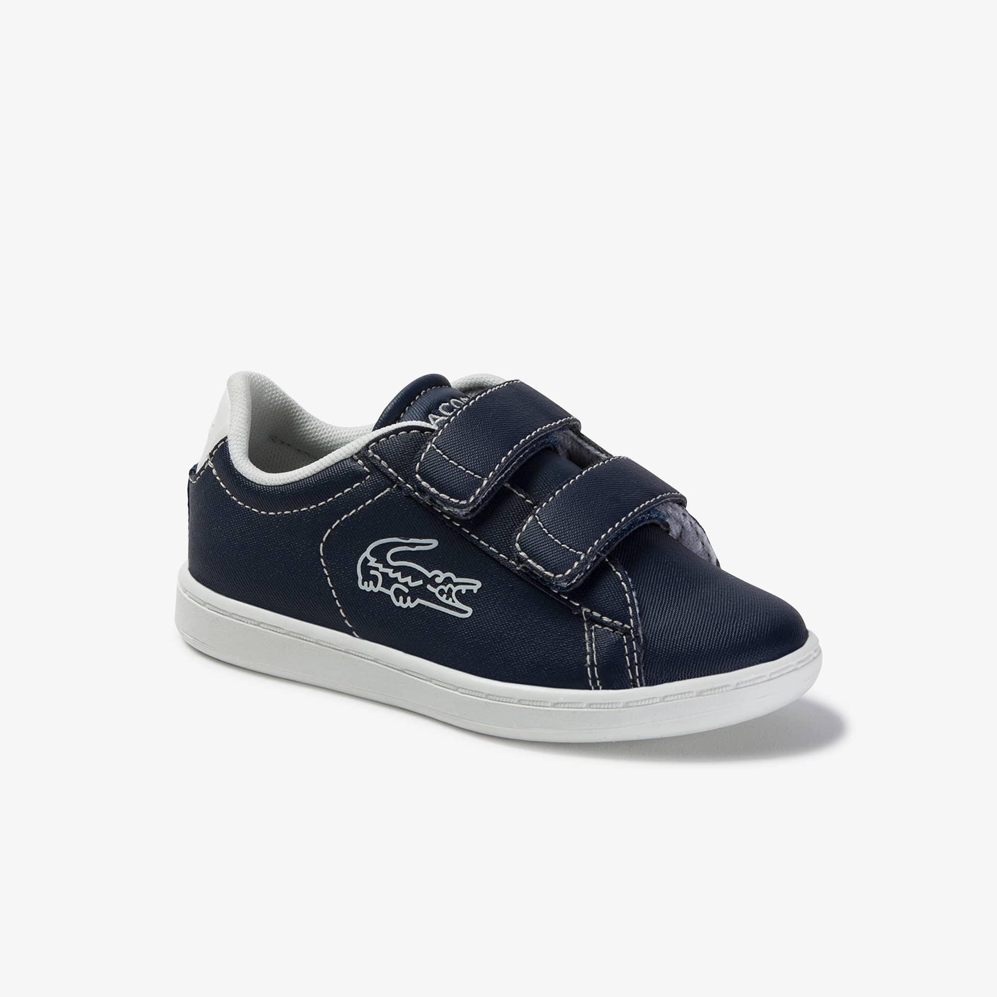 Lacoste Sneakers Carnaby Evo bébé en synthétique à coutures contrastées Taille 20 Marine/beige