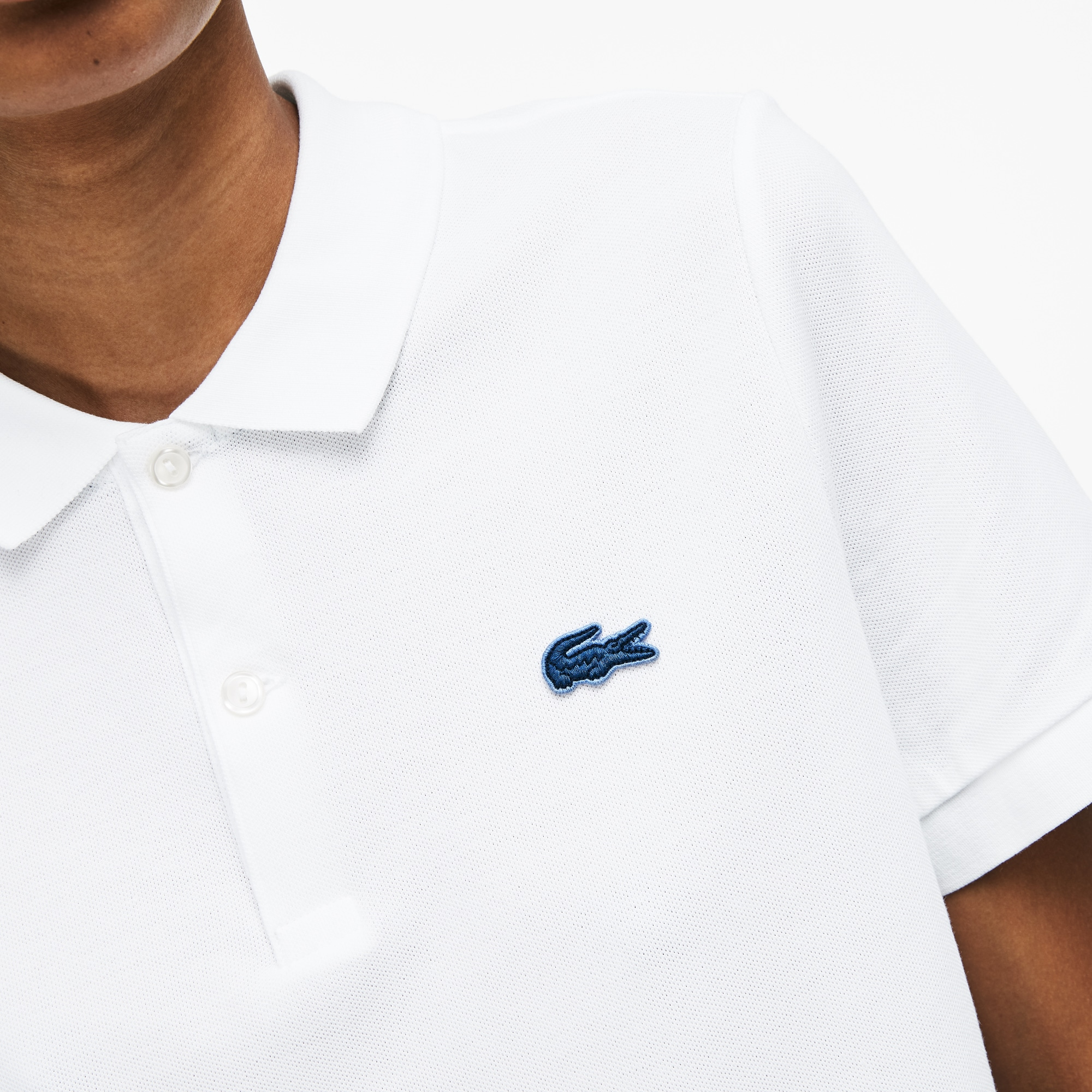 Polo slim fit unisexe Lacoste LIVE en mini piqué stretch uni