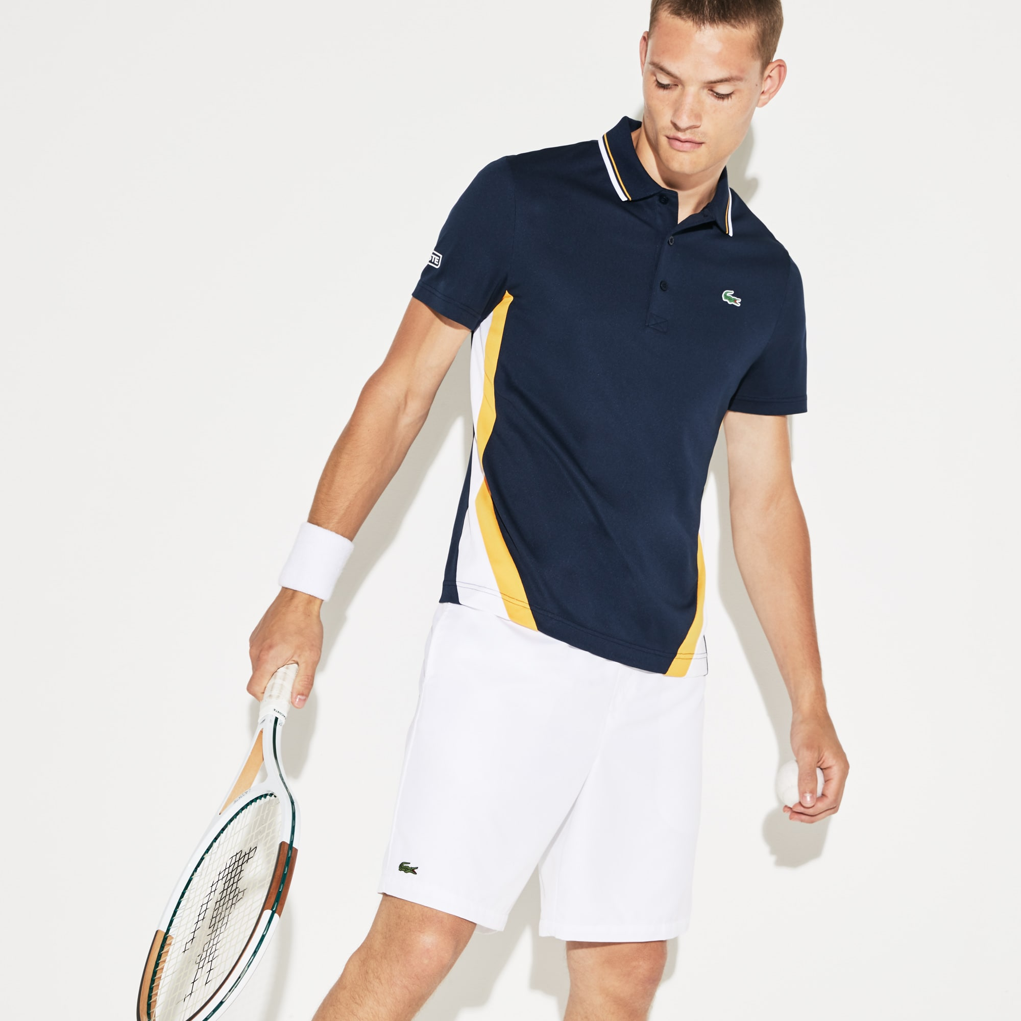 Polo Tennis Lacoste SPORT en piqué technique à bandes color block