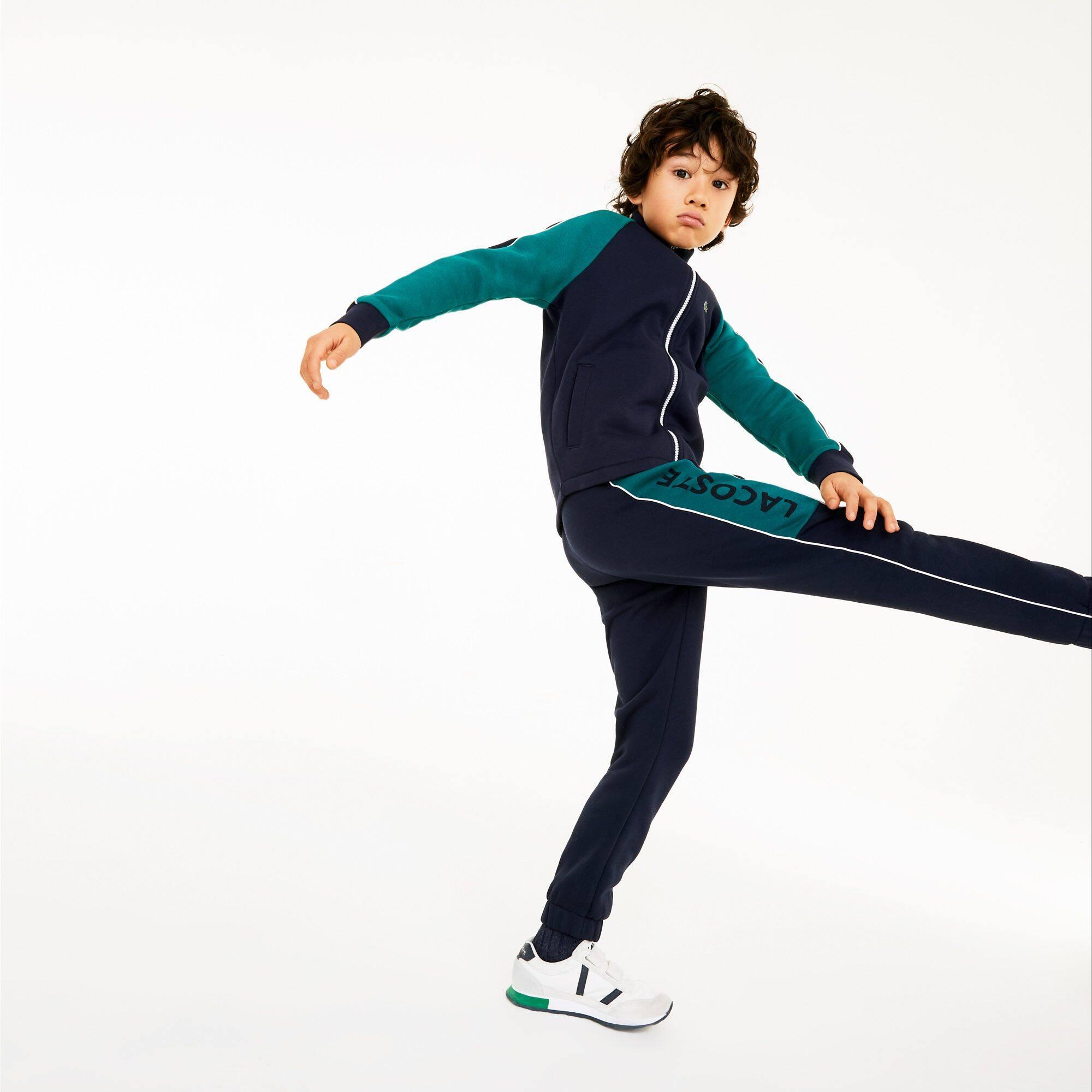 Pantalón de deporte de niño Lacoste SPORT en felpa color block con inscripción