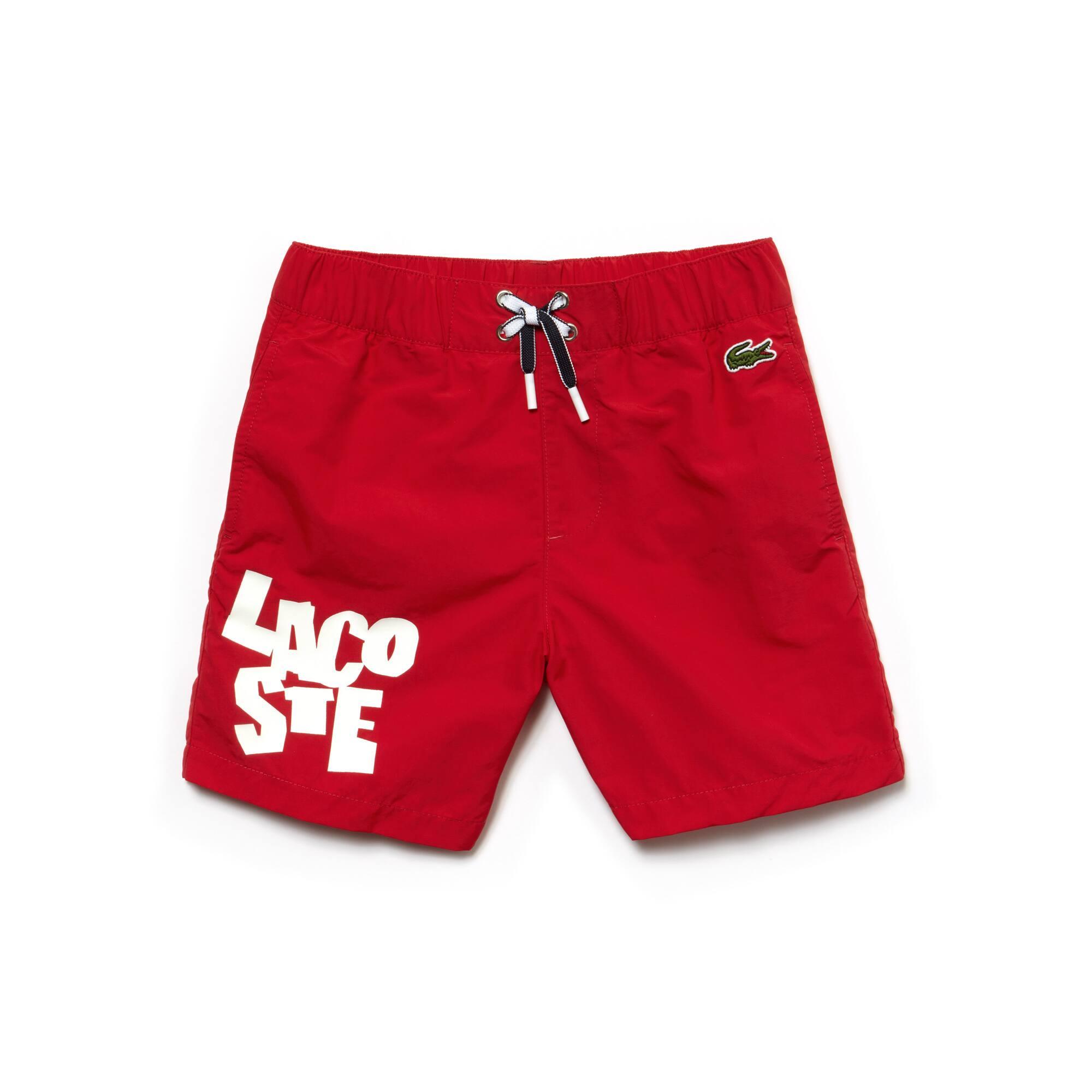 Bañador de tela para chico con letras de la marca Lacoste