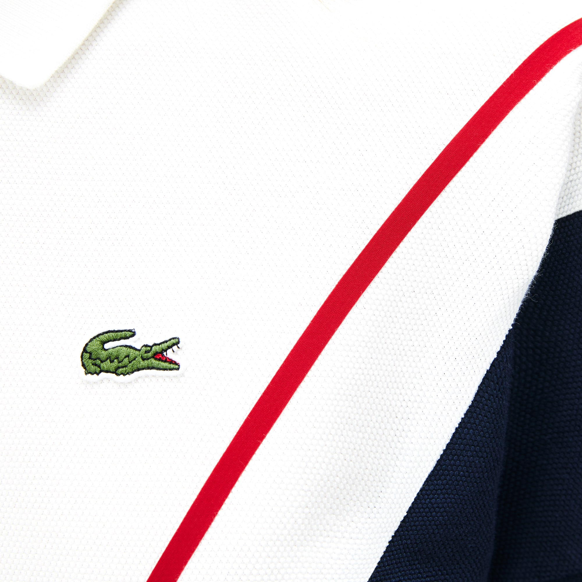 Polo Lacoste Made in France en piqué de coton à motif jacquard