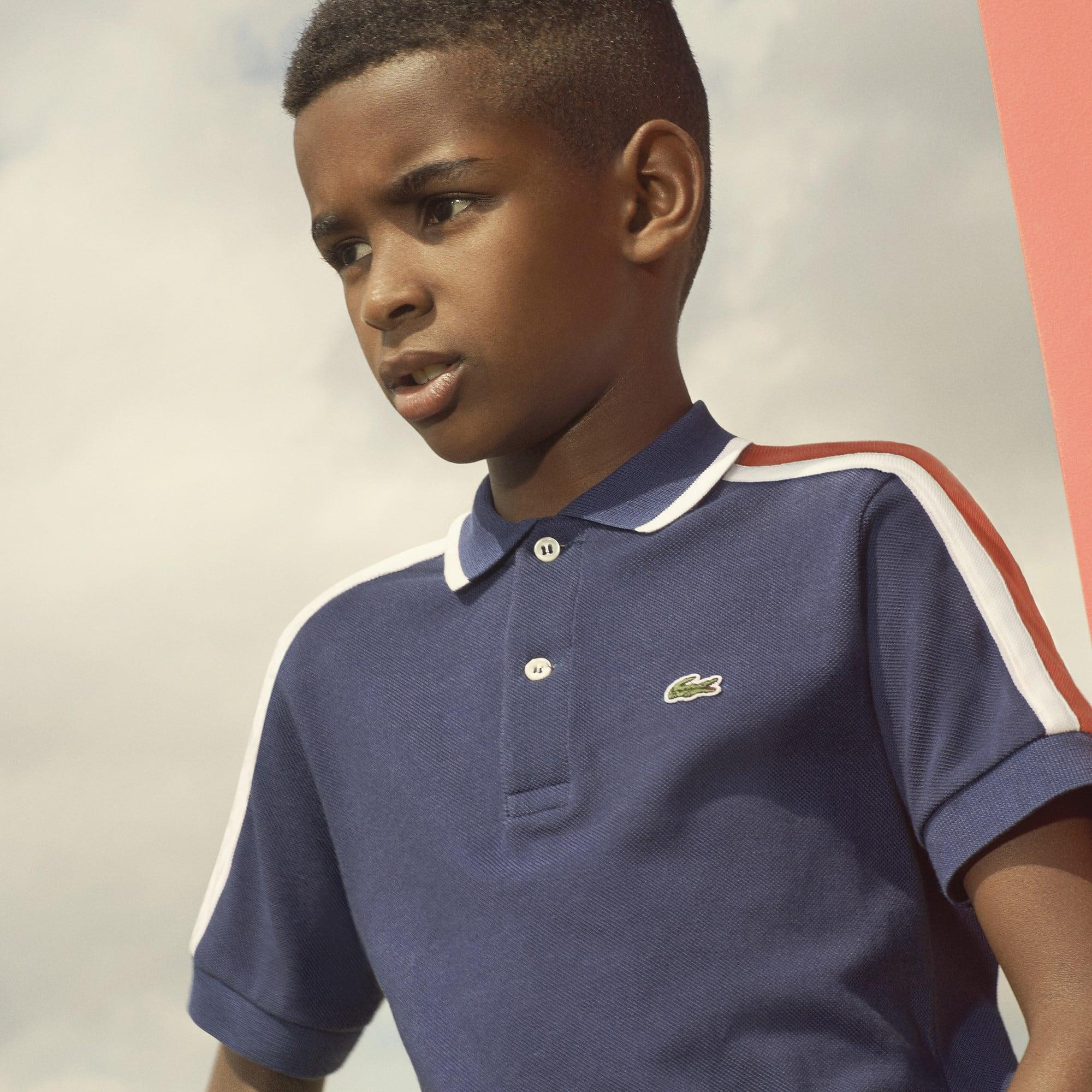 Polo Bambino Lacoste in petit piqué con fasce color block