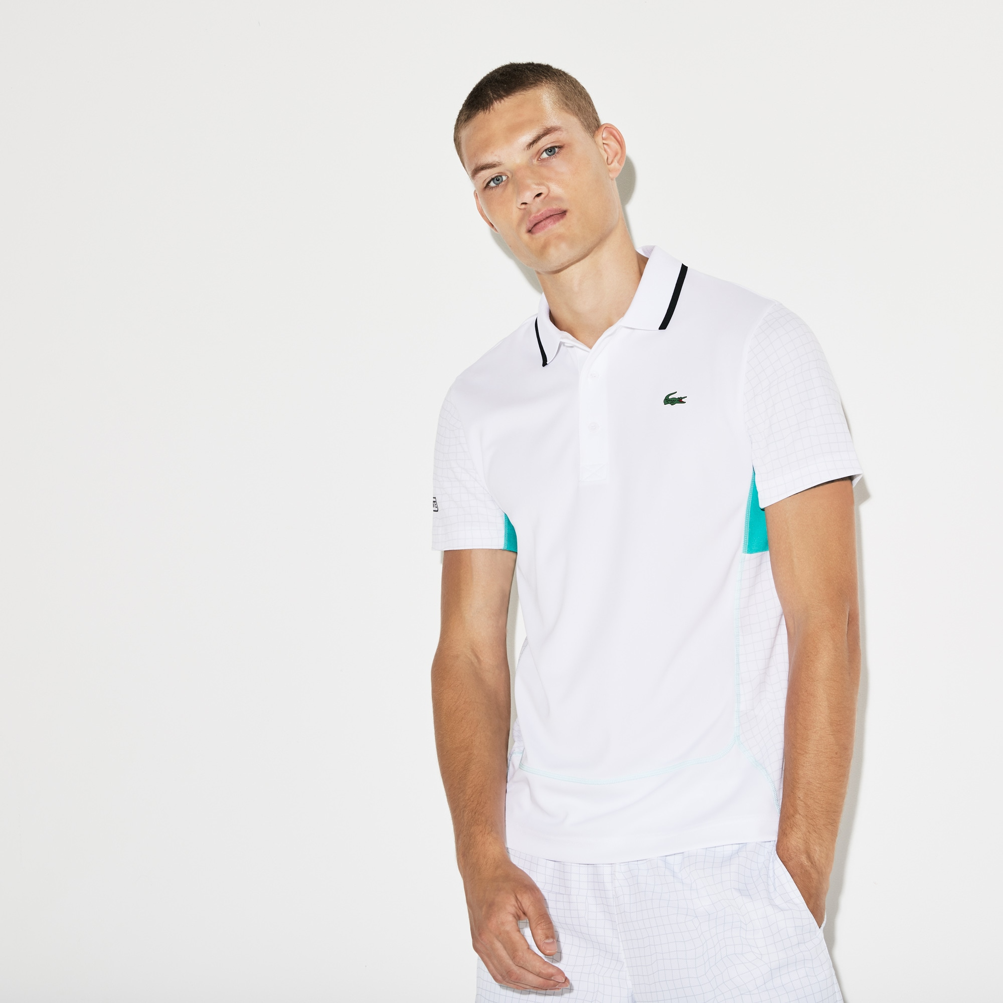 Polo Tennis Lacoste SPORT in piqué tecnico tinta unita e stampa a rete