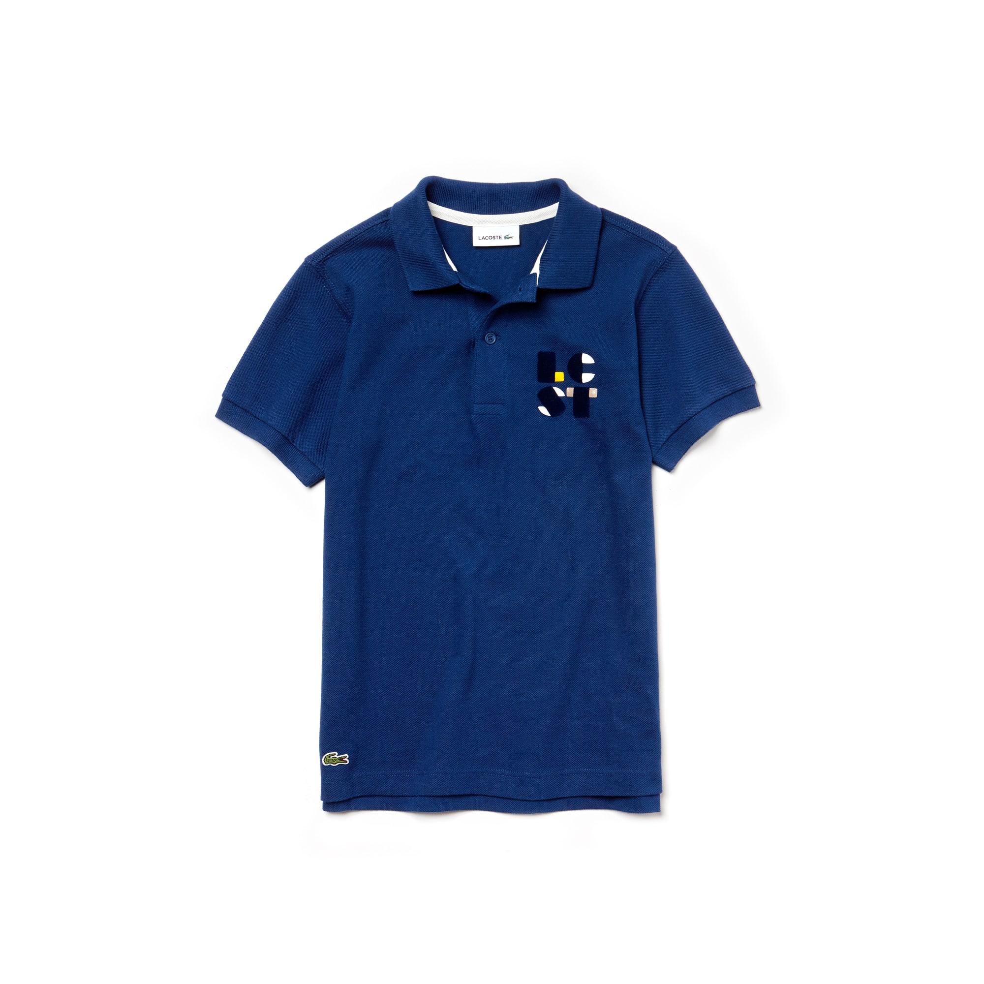 Polo Bambino in petit piqué di cotone con marchio Lacoste