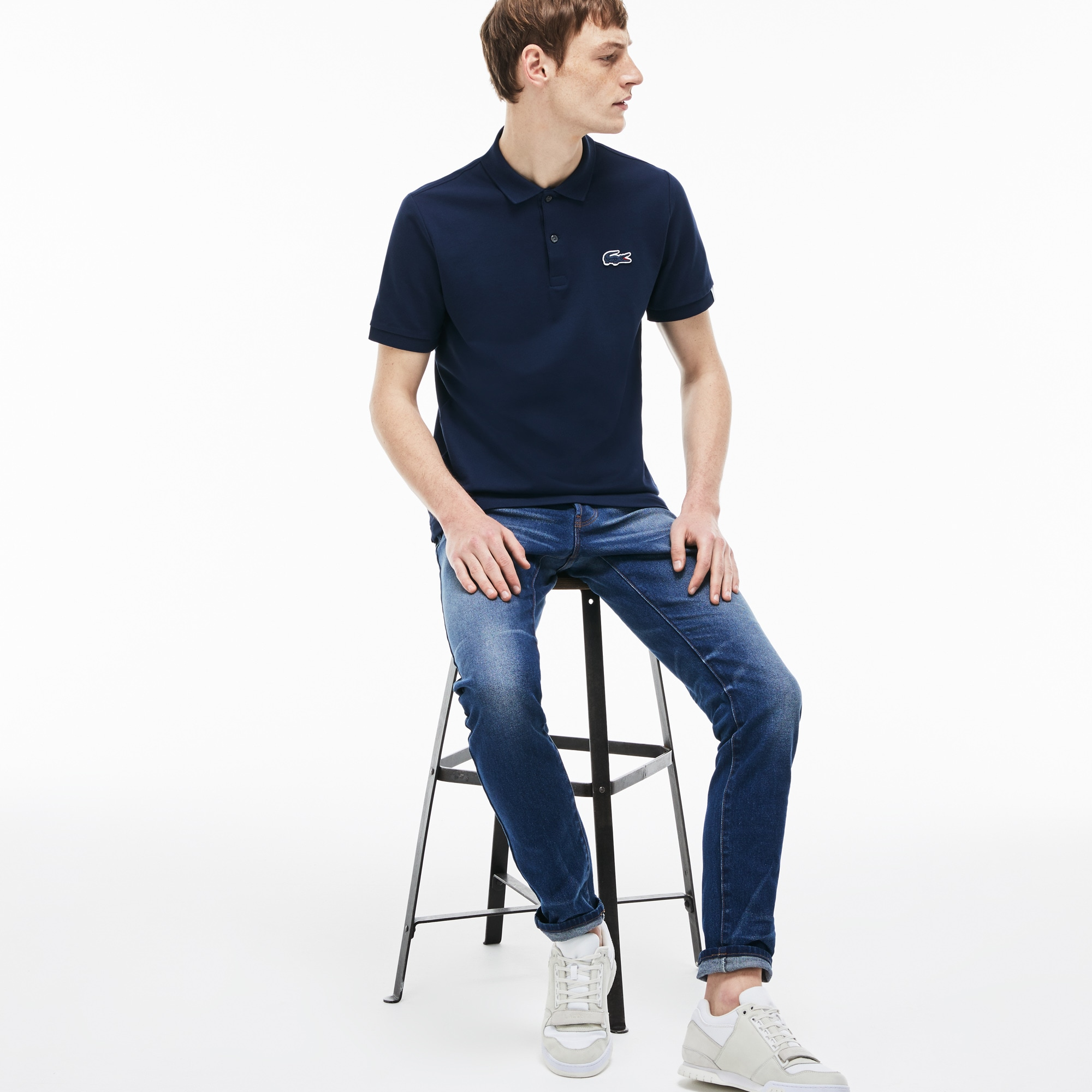 Jeans 5 tasche Lacoste LIVE in denim stretch con risvolti