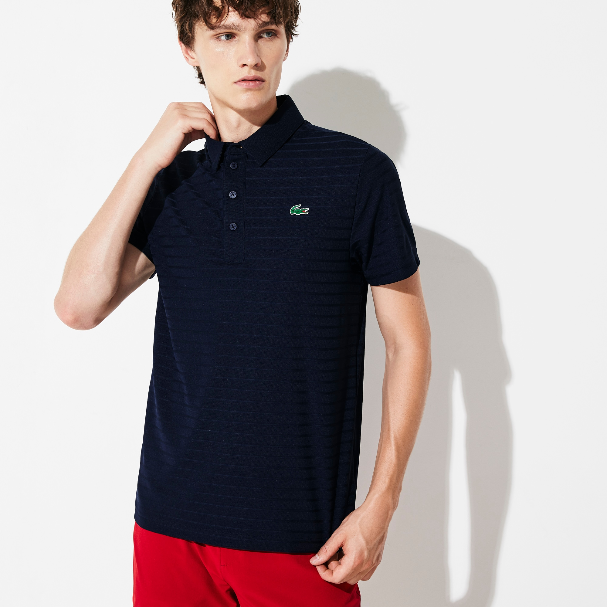 Polo Golf Lacoste SPORT in jersey jacquard tecnico a righe