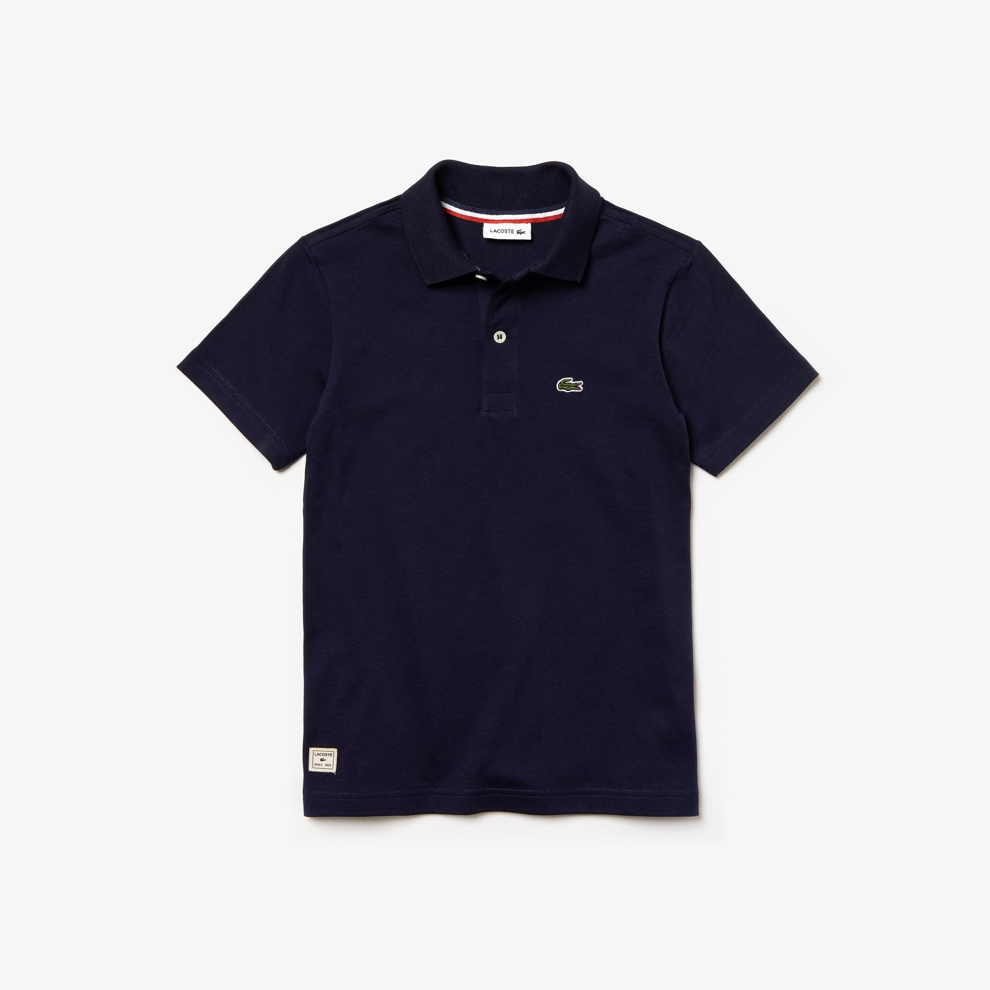 Polo Bambino Lacoste in jersey di cotone tinta unita