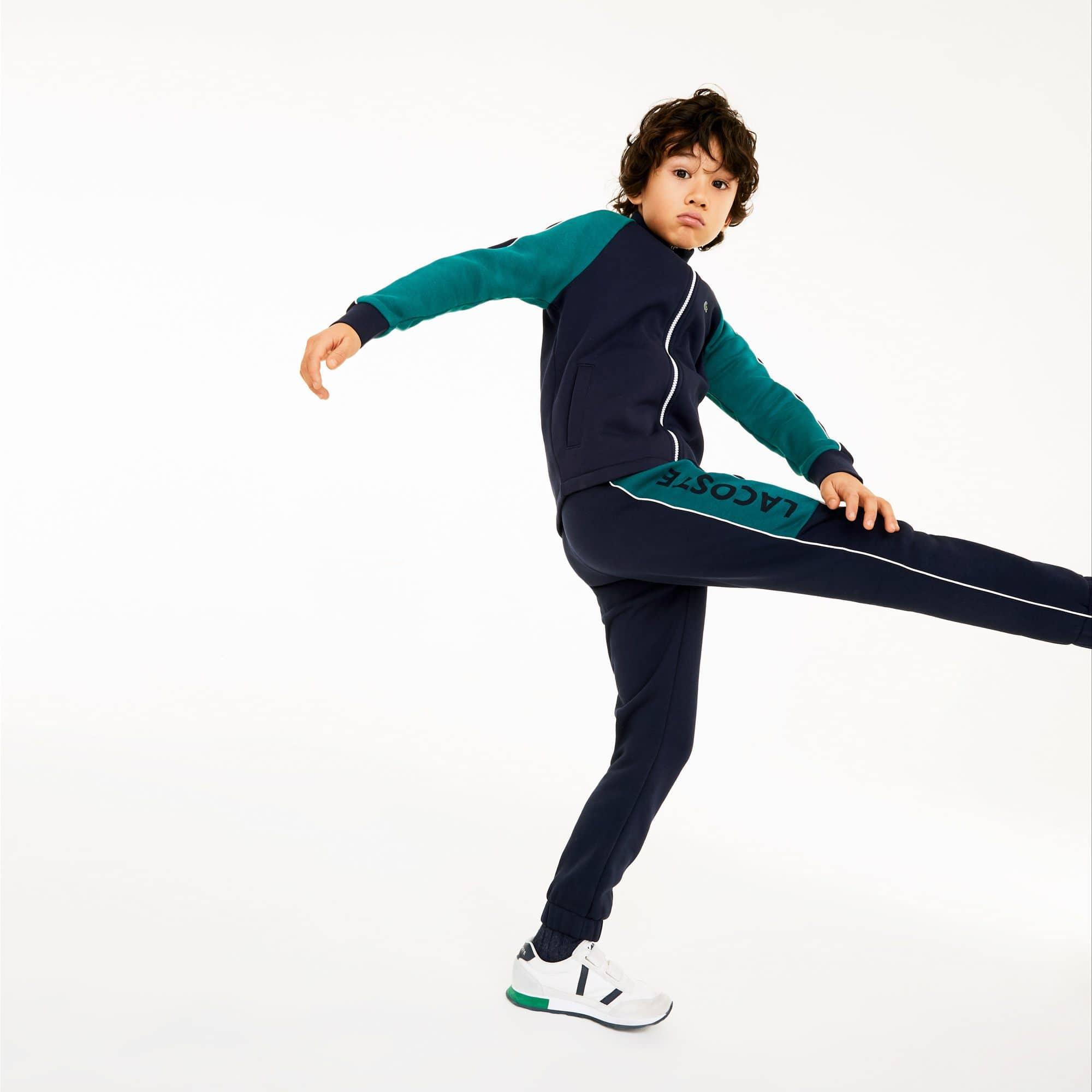 Pantaloni sportivi da bambino in felpa con motivo color block e scritta Lacoste SPORT