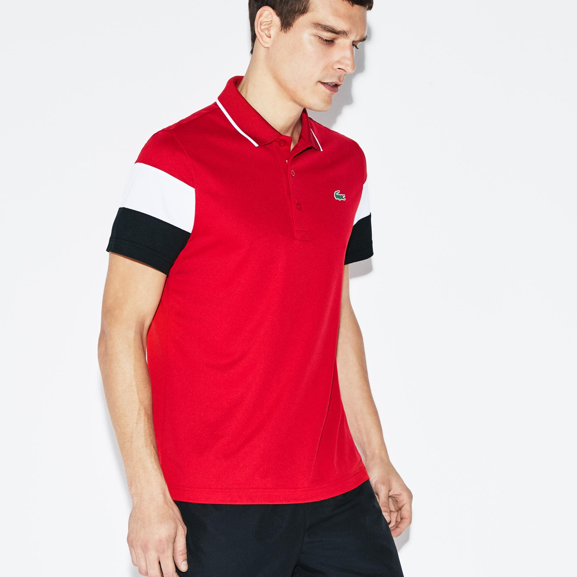 Polo Lacoste SPORT in piqué tecnico con maniche color block