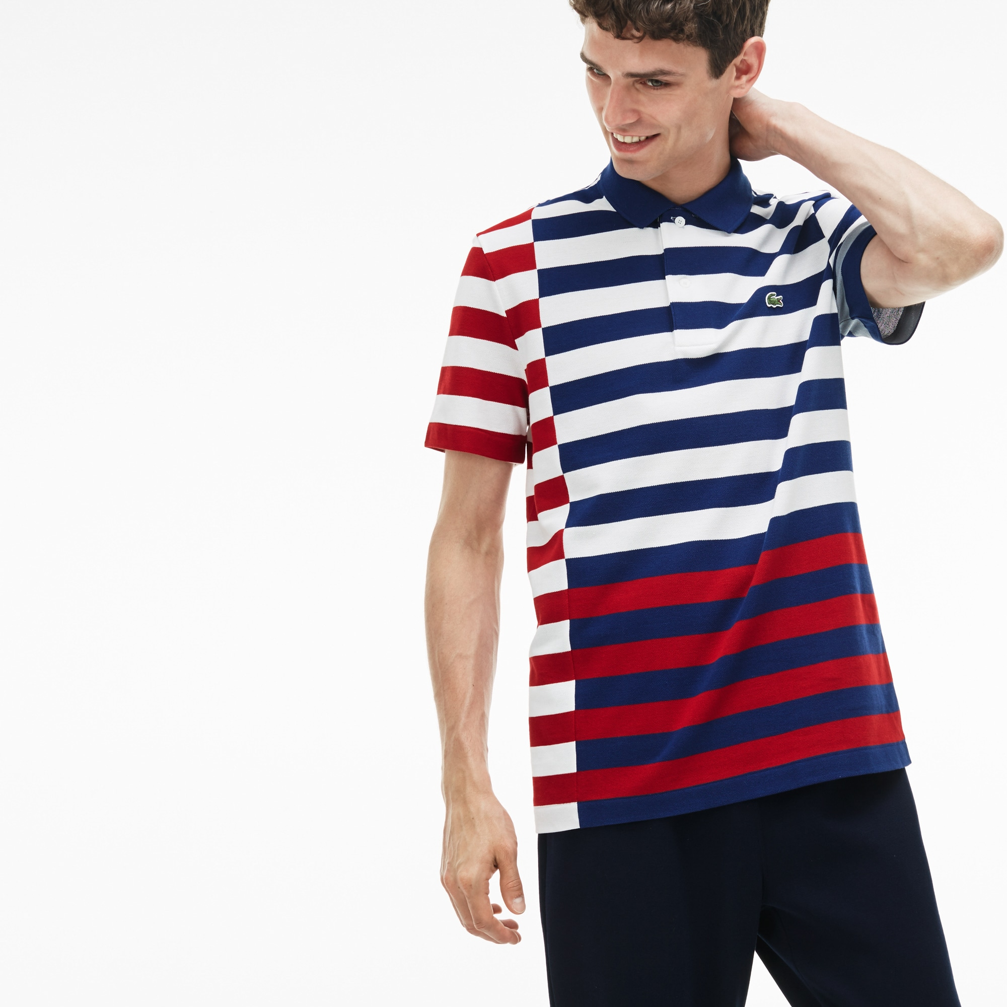 Polo regular fit Lacoste in petit piqué a righe sfalsate e colorate