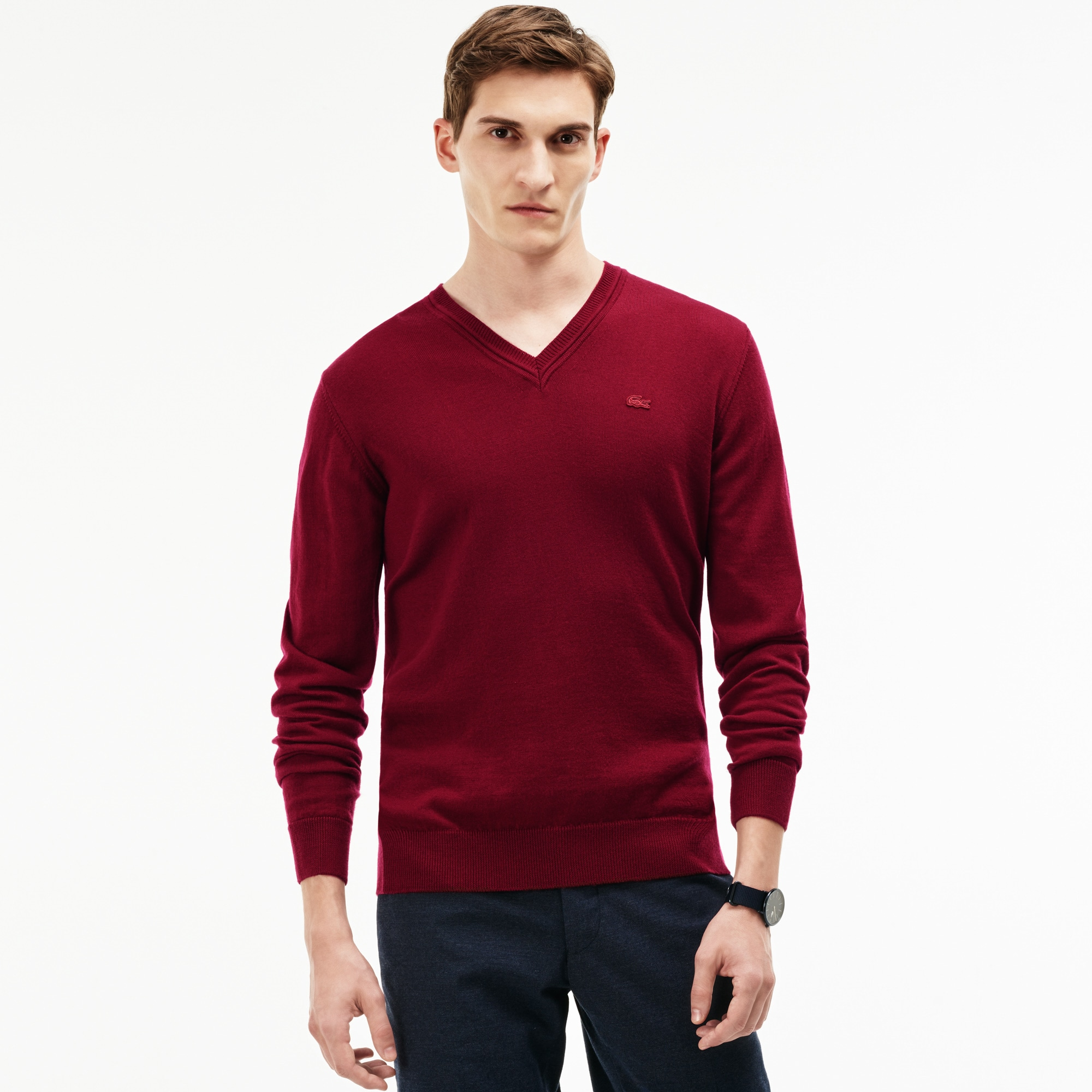 Pullover con collo a V in jersey di lana tinta unita