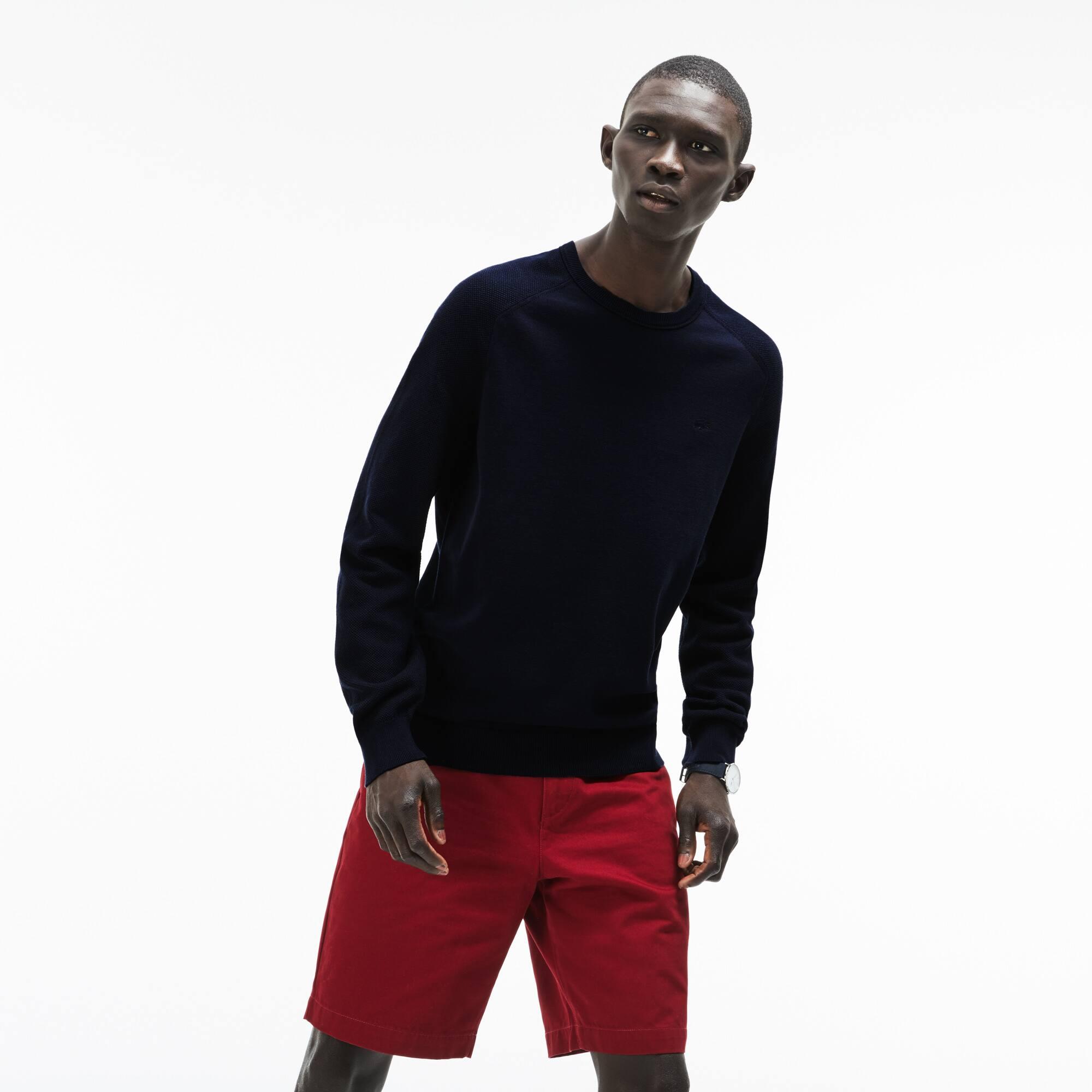 Sweater heren ronde nek met contrasterende mouwen en technisch breiwerk