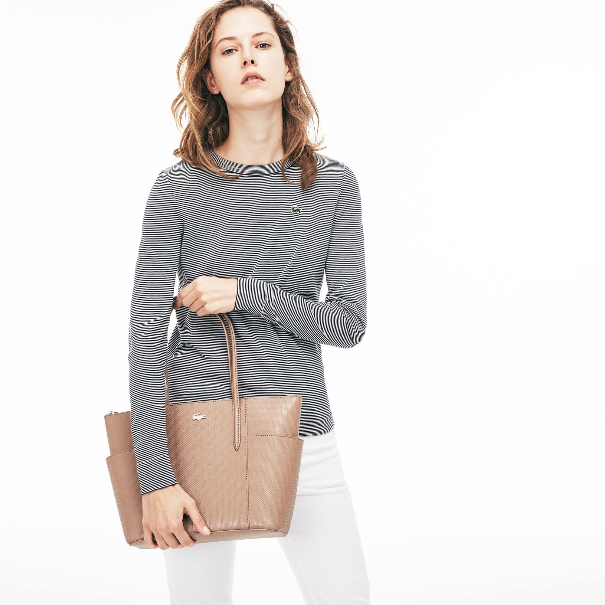 Piqué leren draagtas met zakken met rits