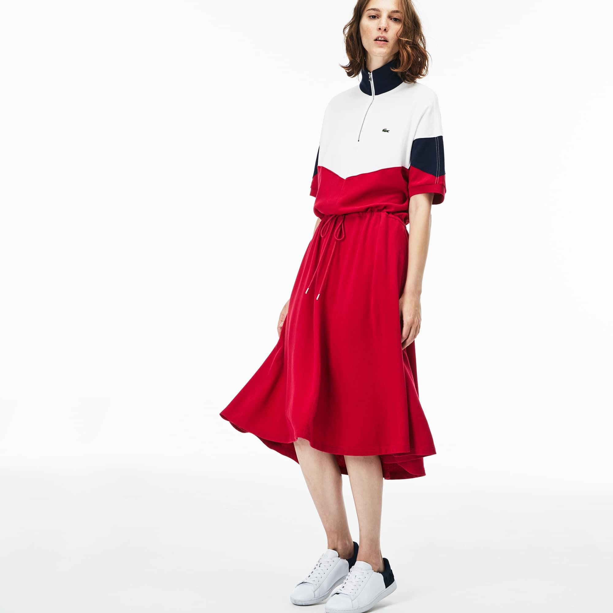 Vestido polo cintado em piqué buclé color block