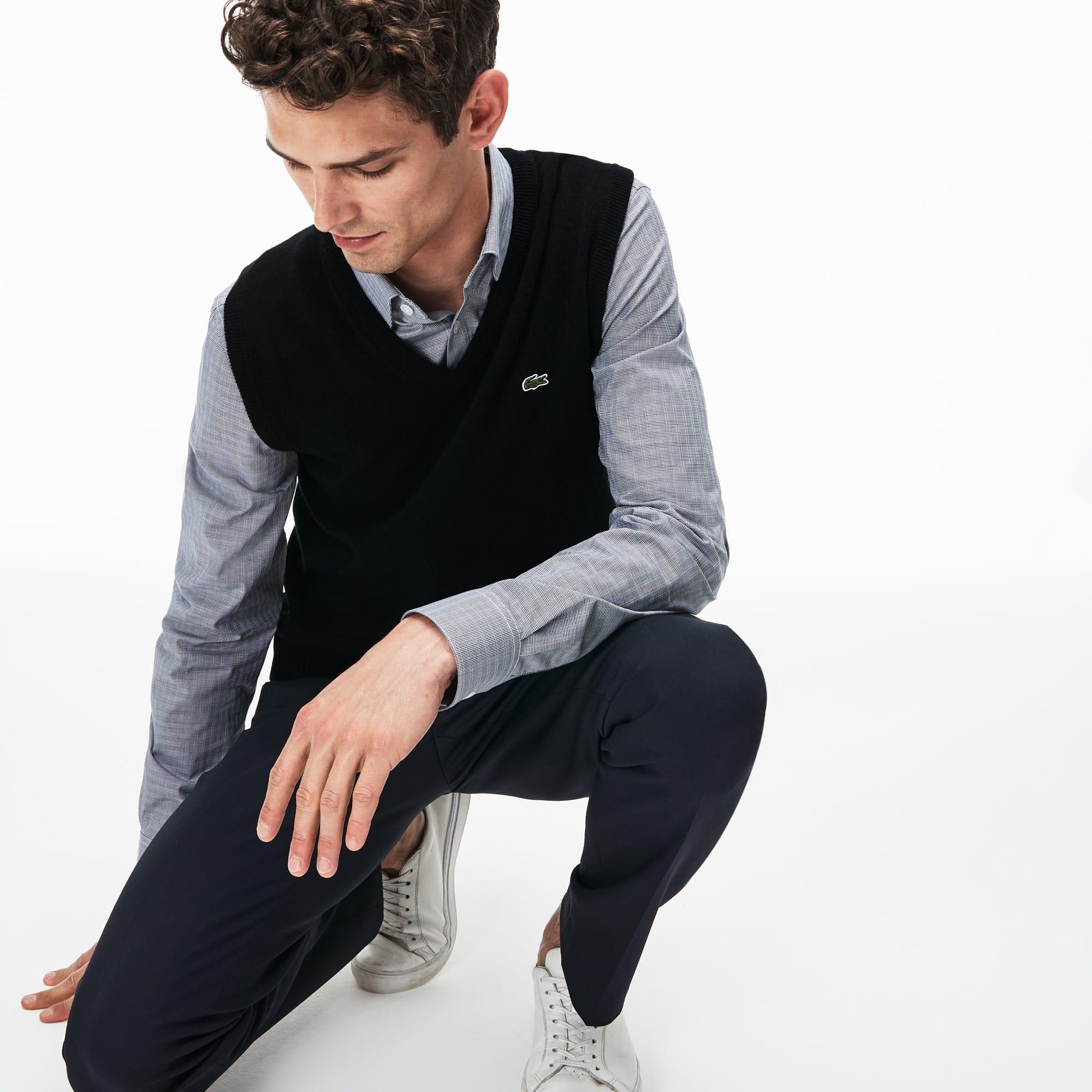 Camisola decote em V sem mangas em jersey de lã unicolor