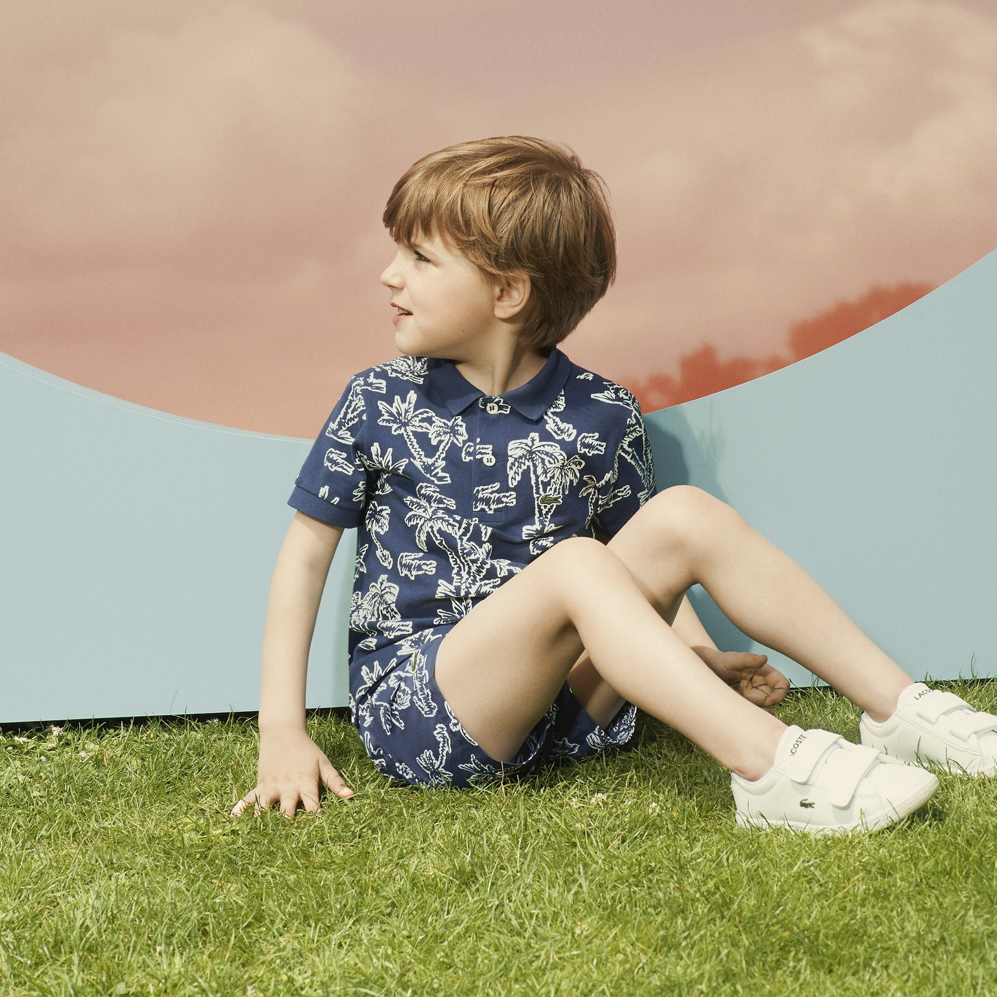 Polo Lacoste Menino em mini piqué de algodão com impressão palmeiras