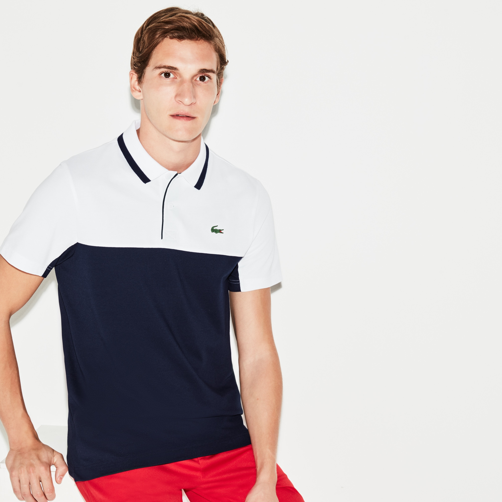 Polo Golf Lacoste SPORT em petit piqué técnico color block