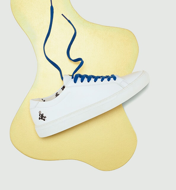 The characters play on the translucent sole of the leather L.12.12 trainers